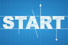 Symbolbild für den Start der KI-Projekte in die Umsetzungsphase, auf der der Schriftzug START in weißer Blockschrift auf blau-kariertem Hintergrund zu sehen ist.